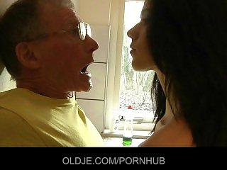 Daring young brunette fucks hard grandpa in the kitchen
