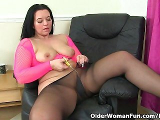 British milf Louise Bassett is fingering her nyloned pussy