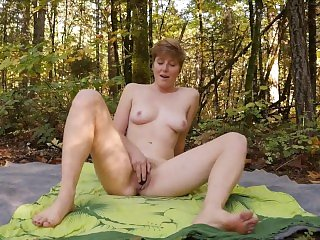 Short Haired Aurora Masturbates Outdoors