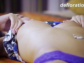 Hot virgin Marlenka enjoys herself in the bed