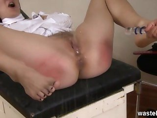 Blonde nurse plays with anal butt plug in her patient