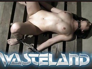 Long blonde haired dominatrix butt plugs and chains sub girl