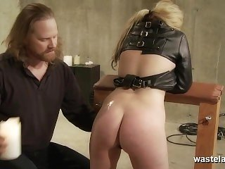 Blonde sex slave is treated to hot wax punishment