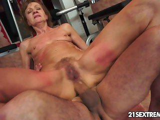 Grandma rides on a huge young cock.