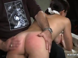 Brunette slave is spanked before orgasms with sex toys