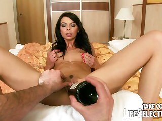 Small girl plays with a huge dildo